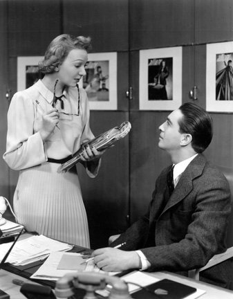 Gertrude Lawrence as Liza Elliott in the original Broadway production of LADY IN THE DARK, 1941.  Liza and Charley Johnson (Macdonald Carey) in the offices of Allure Magazine.