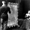 Gertrude Lawrence as Liza Elliott in the original Broadway production of LADY IN THE DARK, 1941.  Liza Elliott's portrait is painted for the 2-cent stamp during the Glamour Dream.