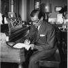 In the quiet of his Paramount Studio office, Irving Berlin puts ...