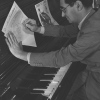 Irving Berlin writing at the piano.