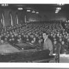 Irving Berlin performing for a large group of soldiers.